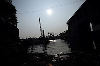 Flood waters push onto industrial land at Dongting Lake, Hunan Province. Dongting Lake has decreased in size in recent decades as a result of land reclamation and damming of the Yangtze. China. 2010