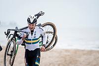 roadie Heinrich Haussler (AUS/Bahrein-McLaren) running on the beach<br /> <br /> UCI 2021 Cyclocross World Championships - Ostend, Belgium<br /> <br /> Elite Men's Race<br /> <br /> ©kramon