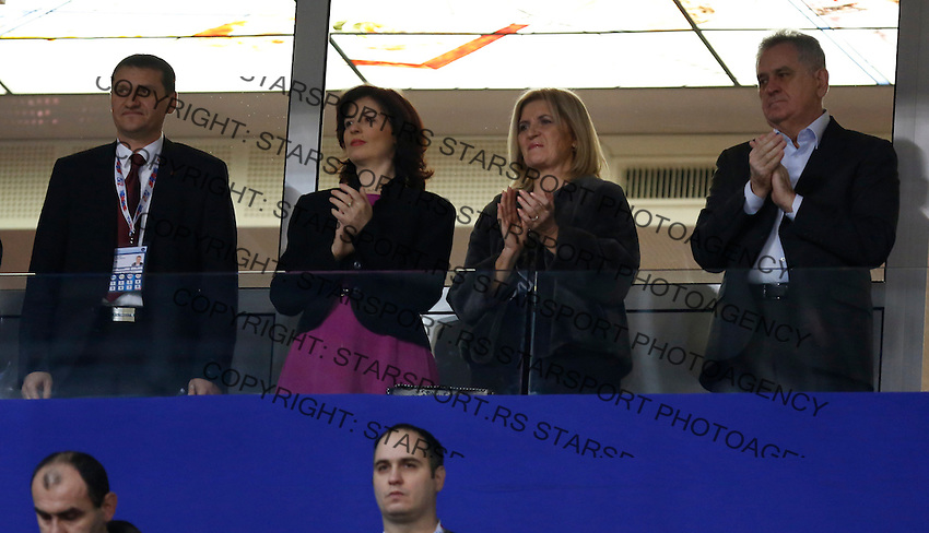 BELGRADE, SERBIA - DECEMBER 16: President of Serbia Tomislav Nikolic (R) with the wife and Ministry of Sport Alisa Maric during the Women's European Handball Championship 2012 medal ceremony at Arena Hall on December 16, 2012 in Belgrade, Serbia. (Photo by Starsportphoto.com)
