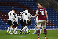 17th February 2021; Turf Moor, Burnley, Lanchashire, England; English Premier League Football, Burnley versus Fulham; Ola Aina of Fulham celebrates his 48th minute opening goal with his team mates