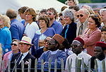 Multicultural group people watching polo game being played Cowdray Park Sussex Uk 1980s