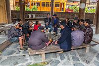 Huanggang, Guizhou, China.  A Dong Ethnic Village.  Men Meeting in a Drum Tower.