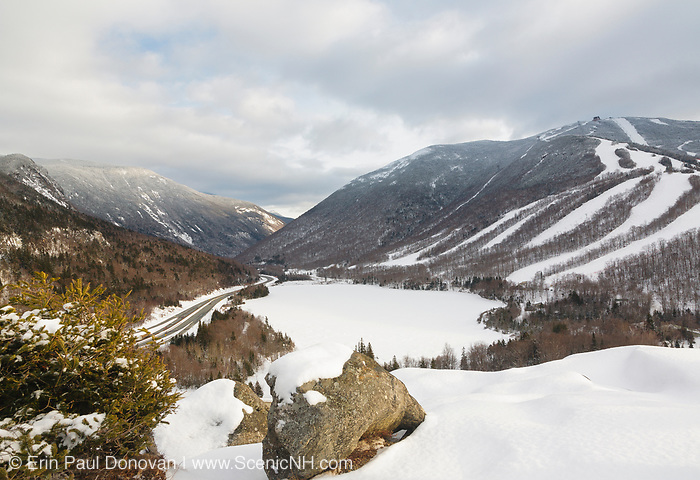 Franconia Notch State Park from Artists Bluff in the White Mountains, New Hampshire on a cloudy winter day. Echo Lake (center) is frozen over and Cannon Mountain is on the right.
