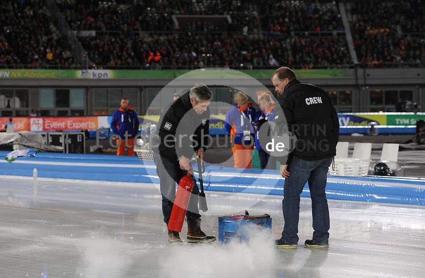 SCHAATSEN: AMSTERDAM: Olympisch Stadion, 28-02-2014, KPN NK Sprint/Allround, Coolste Baan van Nederland, ijsreparatie door Beert Boomsma (ijsmeester), ©foto Martin de Jong
