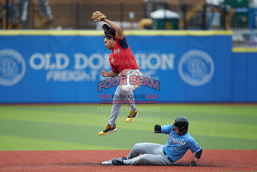 Taye Robinson (35) of Clarksburg High School (VA) playing for the Red Sox scout team jumps for a high throw as Connor Rasmussen (6) of Fort Mill High School (SC) playing for the Kansas City Royals scout team slides into second base during game one of the South Atlantic Border Battle at Truist Point on September 26, 2020 in High Pont, NC. (Brian Westerholt/Four Seam Images)