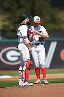 Georgia Bulldogs catcher Shane Marshall (32) has a chat on the mound with starting pitcher C.J. Smith (5) during the game against the LSU Tigers at Foley Field on March 23, 2019 in Athens, Georgia. The Bulldogs defeated the Tigers 2-0. (Brian Westerholt/Four Seam Images)