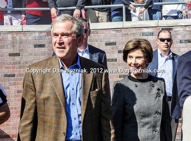 Former First Lady and President George W and  Laura Bush and  participates in the pre game coin toss before the game between the Memphis Tigers and the Southern Methodist Mustangs at the Gerald J. Ford Stadium in Dallas, Texas. SMU defeats Memphis 44 to 13.