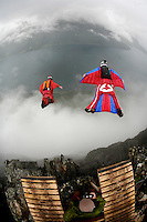 JT Holmes and Tom Erik Heimen throw themeselves off the mountain. World BASE Race held in Innfjorden, Norway, where BASE jumpers in wingsuits compete in flying down the mountain. The winner is called the World's Fastest Flying Human Being..©Fredrik Naumann/Felix Features.