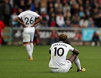 Tammy Abraham of Swansea City sits dejected on the ground after the end of the game during the Premier League match between Swansea City and Watford at The Liberty Stadium, Swansea, Wales, UK. Saturday 23 September 2017