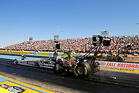 Sept. 24, 2011; Ennis, TX, USA: NHRA top fuel dragster driver Rod Fuller (near lane) races alongside Troy Buff during qualifying for the Fall Nationals at the Texas Motorplex. Mandatory Credit: Mark J. Rebilas-