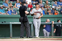 Starting pitcher Avery Weems (24) of the Hickory Crawdads has his hat and glove checked for sticky substances by umpire Mitch Leikam in a game against the Greenville Drive on Friday, August 27, 2021, at Fluor Field at the West End in Greenville, South Carolina. (Tom Priddy/Four Seam Images)