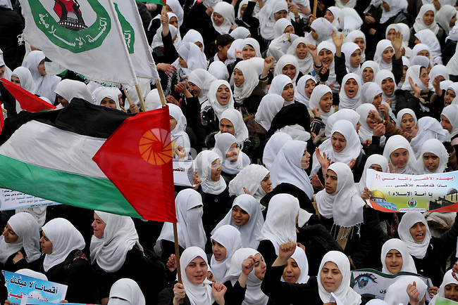 Palestinians female students shout slogans as she and others take part in a protest organized by the Islamic Hamas movement in Gaza city, on February 29, 2012, to show solidarity with Palestinians protesting last week at the Al-Aqsa Mosque Compound in Jerusalem. Photo by Ashraf Amra