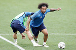 Real Madrid's Marcelo Vieira (r) and Luka Modric during Champions League 2015/2016 training session. May 27,2016. (ALTERPHOTOS/Acero)