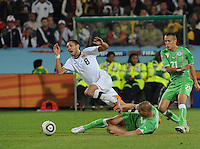 Clint Dempsey is fouled as he builds the U.S. attack outside Algeria's penalty area. The United States won Group C of the 2010 FIFA World Cup in dramatic fashion, 1-0, over Algeria in Pretoria's Loftus Versfeld Stadium, Wednesday, June 23rd..