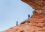 Family enjoying the view from South Window arch in Arches National Park, UT