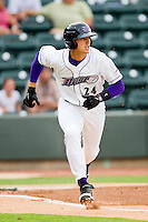 Trayce Thompson #24 of the Winston-Salem Dash hustles down the first base line against the Myrtle Beach Pelicans at BB&T Ballpark on July 5, 2012 in Winston-Salem, North Carolina.  The Dash defeated the Pelicans 12-5.  (Brian Westerholt/Four Seam Images)