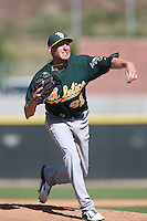 Jeff Urlaub #62 of the Oakland Athletics pitches during a Minor League Spring Training Game against the Los Angeles Angels at the Los Angeles Angels Spring Training Complex on March 17, 2014 in Tempe, Arizona. (Larry Goren/Four Seam Images)