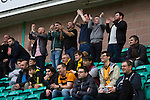 Hibernian 3 Alloa Athletic 0, 12/09/2015. Easter Road stadium, Scottish Championship. Some of the 79 visiting fans applauding their team on to the pitch at Easter Road stadium before the kick-off in the Scottish Championship match between Hibernian and visitors Alloa Athletic. The home team won the game by 3-0, watched by a crowd of 7,774. It was the Edinburgh club's second season in the second tier of Scottish football following their relegation from the Premiership in 2013-14. Photo by Colin McPherson.
