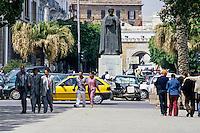 Tunis, Tunisia.  Statue to Ibn Khaldun, Tunisian Historian and Philosopher.  Entrance to medina in Background.