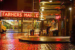 Seattle, Pike Place Farmer's Market, Historical District, Washington State, Pacific Northwest, USA, Central and Sanitary Arcades, Saturday morning set up at the Corner Market, one of many vegetable stands called high stalls, neon signage, reflected across First Avenue,  founded in 1907.