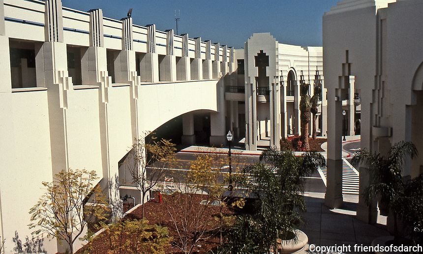 Beverly Hills Civic Center, designed by Charles Moore. A mix of Spanish Revival, Art Deco and Post-Modern styles. It features courtyards, colonnades, promenades, and buildings, with both open and semi-enclosed spaces, stairways and balconies.