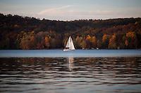 Bill Shaw sails on Lake Lemon on Sunday, Oct. 20, 2014, near Bloomington, Indiana. (Photo by James Brosher)
