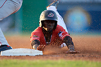 Batavia Muckdogs Milton Smith II (33) slides into third base during a NY-Penn League game against the Auburn Doubledays on June 18, 2019 at Dwyer Stadium in Batavia, New York.  Batavia defeated Auburn 7-5.  (Mike Janes/Four Seam Images)
