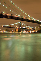 AVAILABLE FROM JEFF AS A FINE ART PRINT.<br /> <br /> AVAILABLE FROM PLAINPICTURE FOR COMMERCIAL AND EDITORIAL LICENSING. Please go to www.plainpicture.com and search for image # p5690061.<br /> <br /> Brooklyn Bridge and East River Illuminated at Night, Manhattan Bridge in the Distance, New York City, New York State, USA