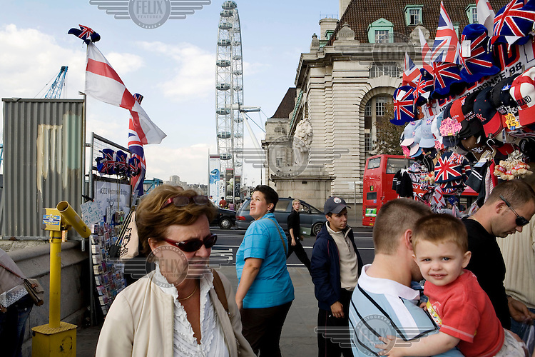 Great Britain flags and other tourist orientated memorabilia on sale next to the London Eye.