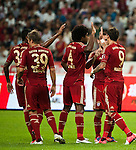GUANGZHOU, GUANGDONG - JULY 26:  Mario Mandzukic of Bayern Munich celebrates with team mates after scoring during a friendly match against VfL Wolfsburg as part of the Audi Football Summit 2012 on July 26, 2012 at the Guangdong Olympic Sports Center in Guangzhou, China. Photo by Victor Fraile / The Power of Sport Images