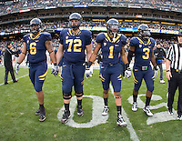 California captains' Trevor Guyton, Mitchell Schwartz, Marvin Jones and D.J. Holt walk on the field for coin toss ceremony before the game against Washington State at AT&T Park in San Francisco, California on November 5th, 2011.  California defeated Washington State, 30-7.