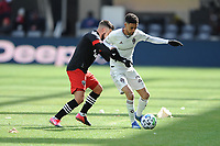 WASHINTON, DC - FEBRUARY 29: Washington, D.C. - February 29, 2020: Younes Namli #21 of the Colorado Rapids battles the ball with Junior Moreno #5 of D.C. United. The Colorado Rapids defeated D.C. United 2-1 during their Major League Soccer (MLS)  match at Audi Field during a game between Colorado Rapids and D.C. United at Audi FIeld on February 29, 2020 in Washinton, DC.