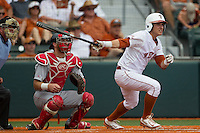 Texas Longhorns outfielder Mark Payton (2) follows through on his swing in front of catcher Caleb Barker (27) during the NCAA Super Regional baseball game against the Houston Cougars on June 7, 2014 at UFCU Disch–Falk Field in Austin, Texas. The Longhorns are headed to the College World Series after they defeated the Cougars 4-0 in Game 2 of the NCAA Super Regional. (Andrew Woolley/Four Seam Images)