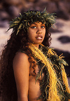A woman hula dancer wears traditional ferns in this half-length portrait at Makena, Maui.