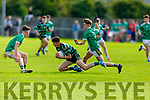 St Brendans Dara O'Sullivan take the mark despite the attention from Jack McElligott and Raymond O'Neill of St Kieran's in the County Minor Football Championship.