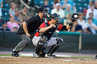 Indianapolis Indians catcher Tony Sanchez #19 catches in front of umpire Jeff Gosney during a game against the Empire State Yankees at Frontier Field on August 4, 2012 in Rochester, New York.  Empire State defeated Indianapolis 9-8 in ten innings.  (Mike Janes/Four Seam Images)