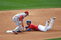 Syracuse Chiefs shortstop Jason Martinson (5) tags Ryan Goins (5) sliding into second base during a game against the Buffalo Bisons on July 31, 2016 at Coca-Cola Field in Buffalo, New York.  Buffalo defeated Syracuse 6-5.  (Mike Janes/Four Seam Images)