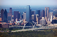 aerial photograph of the Dallas, Texas skyline. the Margarette McDermott Bridge in the foreground