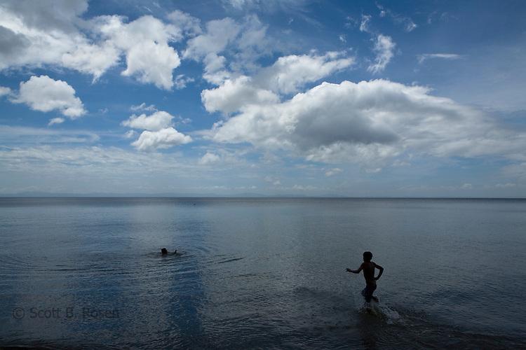 Two Nicaraguan boys go swimming in Lake Nicaragua (Cocibolca) near Merida, Isla Ometepe, Nicaragua