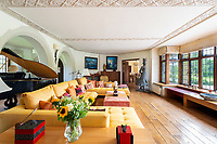BNPS.co.uk (01202 558833)<br /> Pic: Hamptons/BNPS<br /> <br /> Pictured: A living room with a view of the garden.<br /> <br /> An incredible Arts and Crafts country house with its own vineyard is on the market for offers over £7m.<br /> <br /> The Grade II listed St Joseph's Hall is a striking 111-year-old property that was home to the Bishop of Arundel for 40 years.<br /> <br /> It has a wealth of period features, an indoor swimming pool and seven acres of vineyard with mostly Chardonnay grapes, which the owners sell to a local winery.<br /> <br /> The house in Storrington, West Sussex, has 17 acres of land with beautiful views over the South Downs.