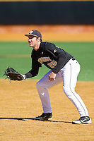 First baseman Matt Conway (25) of the Wake Forest Demon Deacons on defense against the Youngstown State Penguins at Wake Forest Baseball Park on February 24, 2013 in Winston-Salem, North Carolina.  The Demon Deacons defeated the Penguins 6-5.  (Brian Westerholt/Four Seam Images)