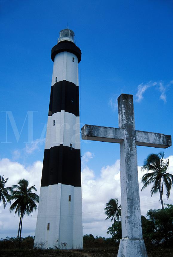 Lighthouse and cross on hill overlloking Porto de Pedras, Alagoas, Brazi