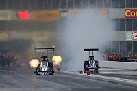 Apr. 26, 2013; Baytown, TX, USA: NHRA top fuel dragster driver Larry Dixon (left) races alongside J.R. Todd during qualifying for the Spring Nationals at Royal Purple Raceway. Mandatory Credit: Mark J. Rebilas-
