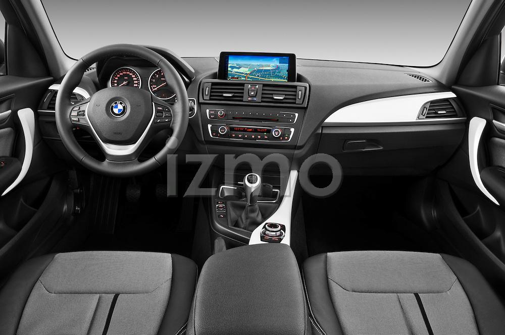 Straight dashboard view of a 2011 - 2014 BMW 118d 5 Door hatchback.