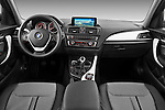 Straight dashboard view of a 2011 - 2014 BMW 118d 5 Door hatchback.