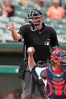 Home plate umpire Chad Whitson during an Arizona Fall League game between the Mesa Solar Sox and Salt River Rafters at HoHoKam Park on November 4, 2011 in Mesa, Arizona.  Mesa defeated Salt River 12-10.  (Mike Janes/Four Seam Images)