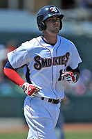 Tennessee Smokies third baseman Kris Bryant #17 heads to first after being intentionally walked during a game against Chattanooga Lookouts at Smokies Park on April 10, 2014 in Kodak, Tennessee. The Lookouts defeated the Smokies 1-0. (Tony Farlow/Four Seam Images)