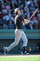 South Carolina Gamecocks right fielder Connor Bright #4 swings at a pitch during a game against the Clemson Tigers at Fluor Field on March 1, 2014 in Greenville, South Carolina. The Gamecocks defeated the Tigers 10-2. (Tony Farlow/Four Seam Images)
