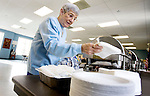 WOLCOTT CT. 30 December 2013-123013SV06-Audrey Newvine of Waterbury sets up the brunch line at the senior center in Wolcott Monday. The seniors celebrate the New Year with an annual brunch before it closes on Tuesday and Wednesday for the holiday. About 40 seniors attended. <br /> Steven Valenti Republican-American