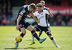 Ross County v St Johnstone…..30.04.16  Global Energy Stadium, Dingwall<br />Danny Swanson is tackled by Marcus Fraser<br />Picture by Graeme Hart.<br />Copyright Perthshire Picture Agency<br />Tel: 01738 623350  Mobile: 07990 594431
